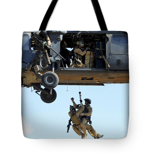 Pararescuemen Are Hoisted Into An Hh-60 Tote Bag by Stocktrek Images
