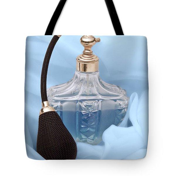 Perfume Bottle Still Life I In Blue Tote Bag by Tom Mc Nemar