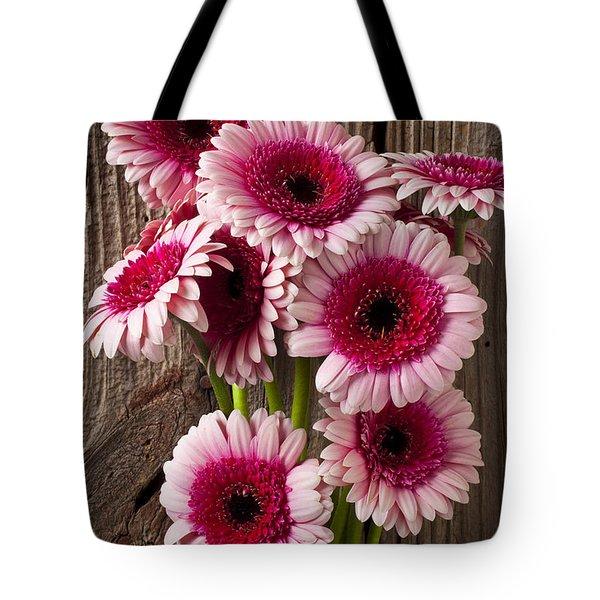 Pink Gerbera daisies Tote Bag by Garry Gay