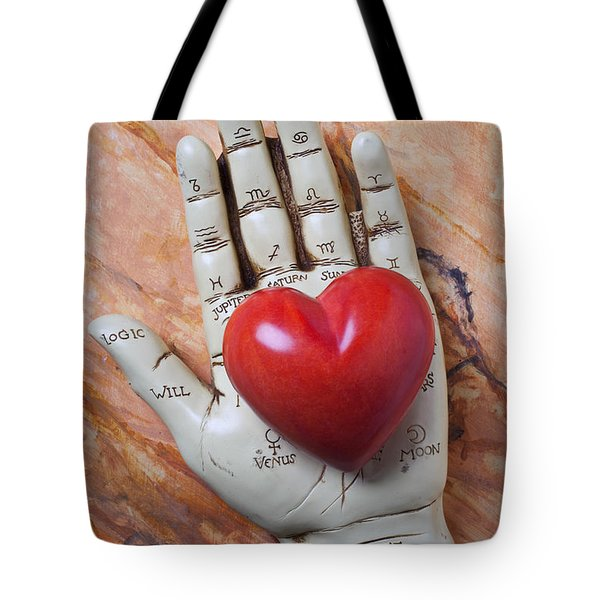 Plam reader hand holding red stone heart Tote Bag by Garry Gay