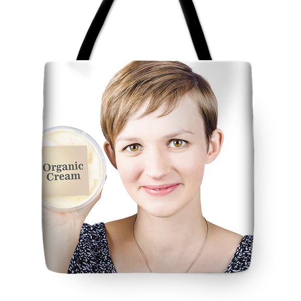 Pretty woman holding a tub of Organic Cream Tote Bag by Ryan Jorgensen