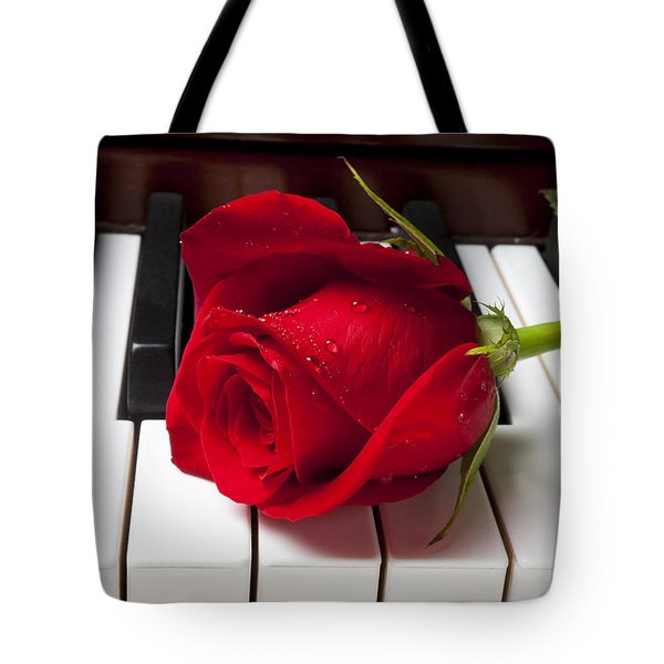Red rose on piano keys Tote Bag by Garry Gay