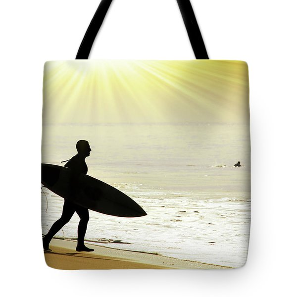 rushing surfer Tote Bag by Carlos Caetano