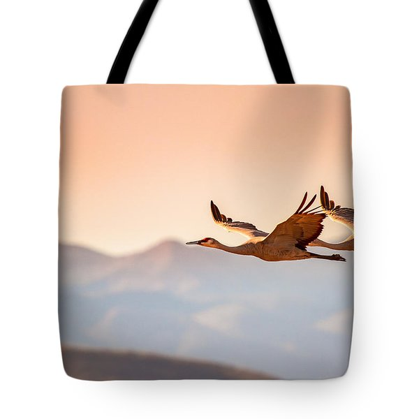 Sandhill Cranes Flying Over New Mexico Mountains - Bosque Del Apache, New Mexico Tote Bag by Ellie Teramoto