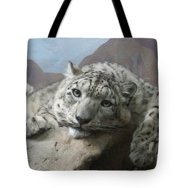 Snow Leopard Relaxing Tote Bag by Ernie Echols