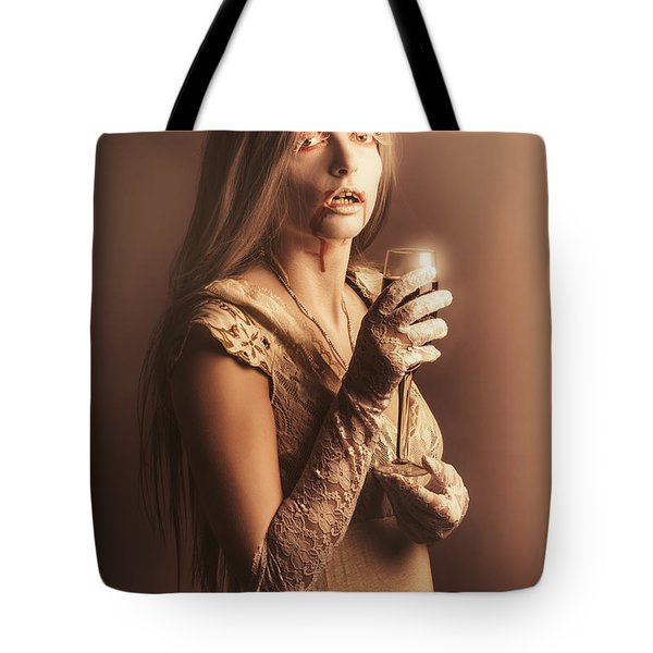 Spooky Vampire Girl Drinking A Glass Of Red Wine Tote Bag by Jorgo Photography - Wall Art Gallery