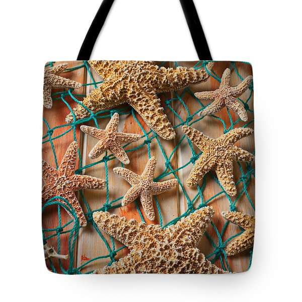 Starfish In Net Tote Bag by Garry Gay