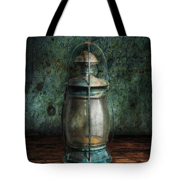 Steampunk - An old lantern Tote Bag by Mike Savad