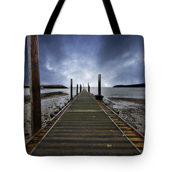 stormy jetty Tote Bag by Meirion Matthias