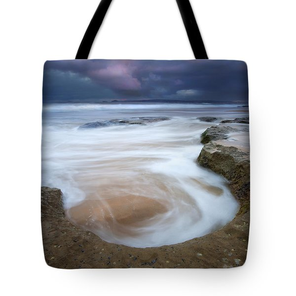 Stormy Sunrise Tote Bag by Mike  Dawson
