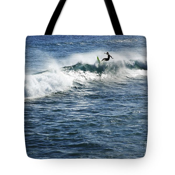Surfer riding a wave Tote Bag by Brandon Tabiolo - Printscapes