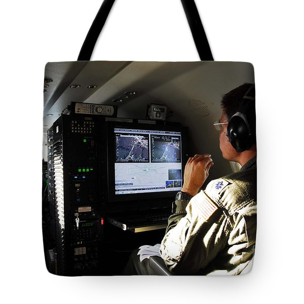 System Operator Operates A Console Tote Bag by Stocktrek Images
