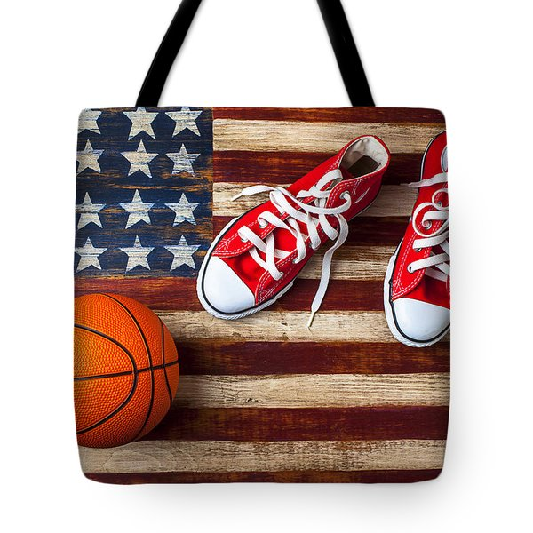 Tennis shoes and basketball on flag Tote Bag by Garry Gay