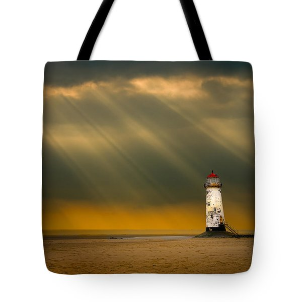the lighthouse as the storm breaks Tote Bag by Meirion Matthias