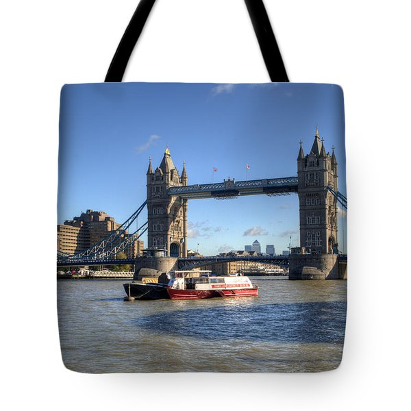 Tower Bridge With Canary Wharf In The Background Tote Bag by Chris Day