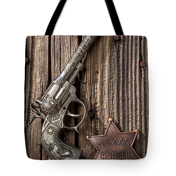 Toy gun and ranger badge Tote Bag by Garry Gay