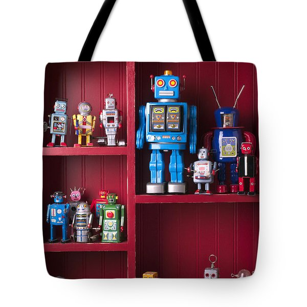 Toy robots on shelf  Tote Bag by Garry Gay