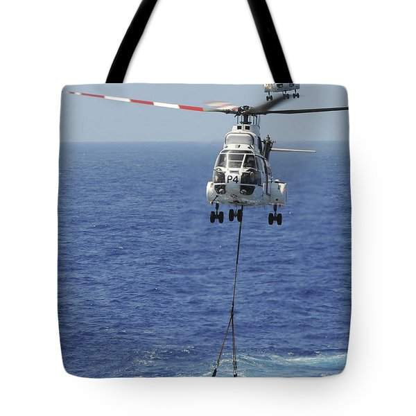 Two Sa-330 Puma Helicopters Deliver Tote Bag by Stocktrek Images