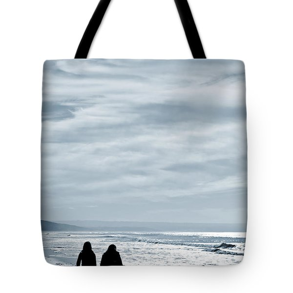 two women walking at the beach in the winter Tote Bag by Jose Elias - Sofia Pereira