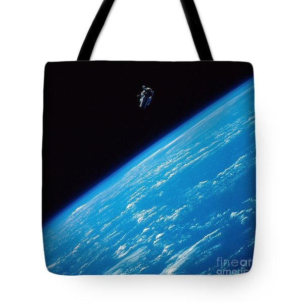 Unattached Space Walk Tote Bag by Stocktrek Images