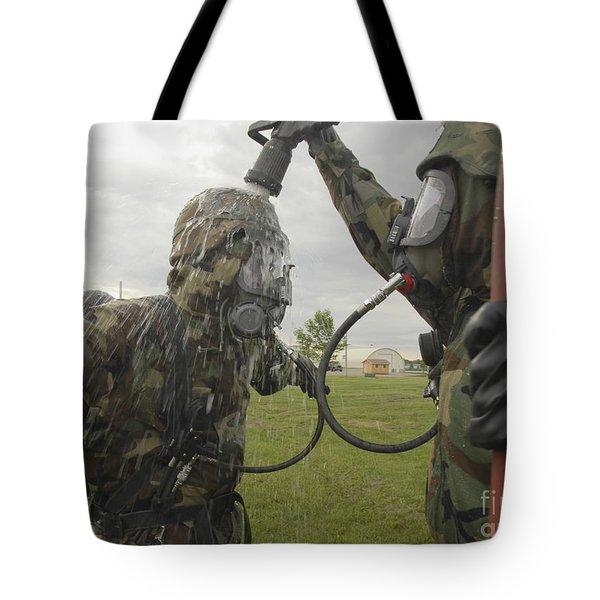 U.s. Air Force Soldier Decontaminates Tote Bag by Stocktrek Images