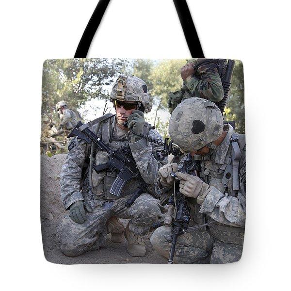 U.s. Army Soldier Radios In His Teams Tote Bag by Stocktrek Images