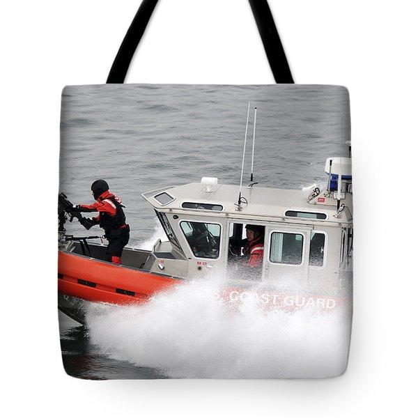 U.s. Coast Guardsmen Aboard A Security Tote Bag by Stocktrek Images
