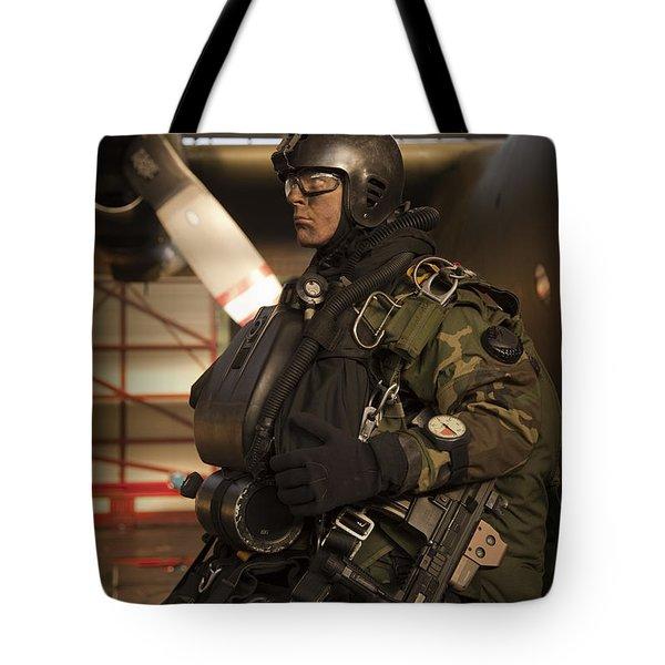 U.s. Navy Seal Combat Diver Prepares Tote Bag by Tom Weber