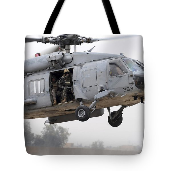 U.s. Special Forces Conduct Assault Tote Bag by Stocktrek Images