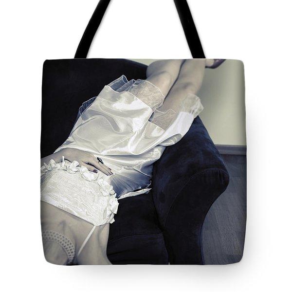 woman lying on chair Tote Bag by Joana Kruse