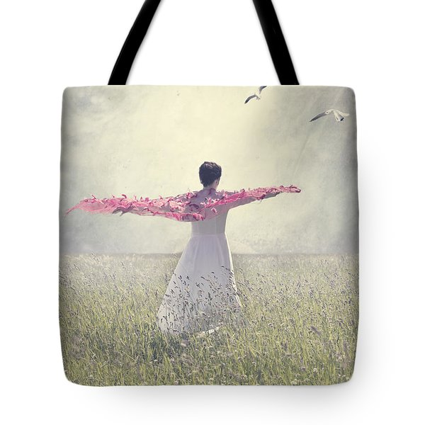 woman on a lawn Tote Bag by Joana Kruse