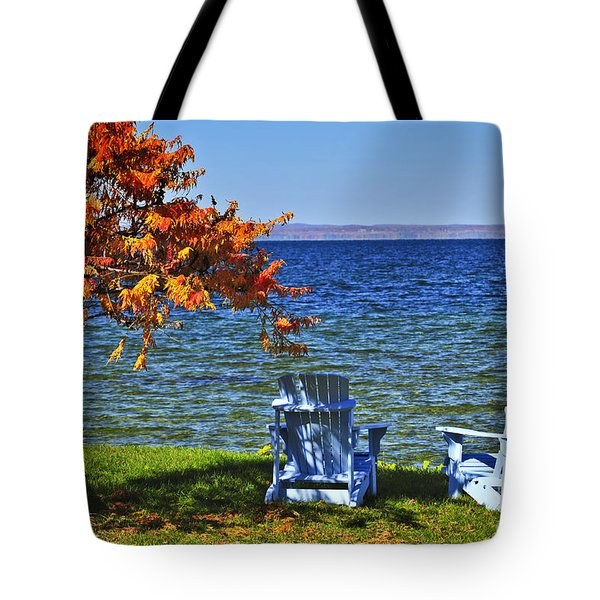 Wooden chairs on autumn lake Tote Bag by Elena Elisseeva