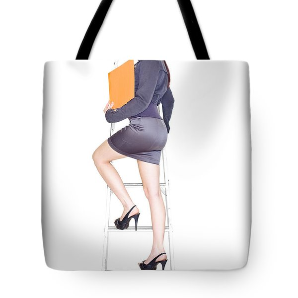 Young Business Woman Climbing The Corporate Ladder Tote Bag by Ryan Jorgensen