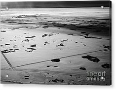 aerial view of snow covered prairies and remote isolated farmland in Saskatchewan Canada Acrylic Print by Joe Fox