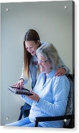 Girl Showing Grandmother Tablet Acrylic Print by Samuel Ashfield