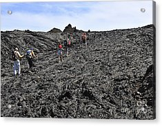 Group Of Hickers Walking On Cooled Lava Acrylic Print by Sami Sarkis