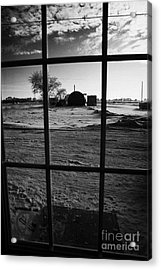 looking out through door window to snow covered scene in small rural village of Forget Saskatchewan  Acrylic Print by Joe Fox