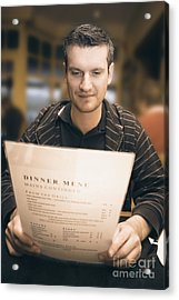 Man In Mid 20s Reading Restaurant Dinner Menu Acrylic Print by Jorgo Photography - Wall Art Gallery
