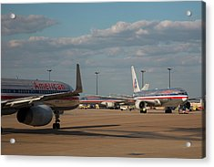 Passenger Airliners At An Airport Acrylic Print by Jim West