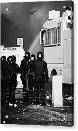 Psni Riot Officers Behind Armoured Land Rover And Water Cannon On Crumlin Road At Ardoyne Shops Belf Acrylic Print by Joe Fox