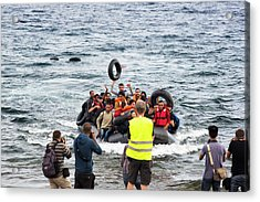 Syrian Refugees Arriving On Greek Island Acrylic Print by Ashley Cooper