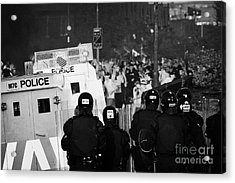 Psni Riot Officers Face Rioters Mob On Crumlin Road At Ardoyne Shops Belfast 12th July Acrylic Print by Joe Fox