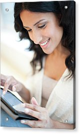 Woman Using Tablet Acrylic Print by Ian Hooton