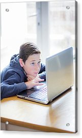 Boy Using A Laptop Acrylic Print by Samuel Ashfield