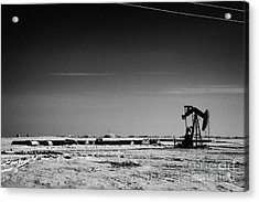 snow covered prairie agricultural farming land with pumpjacks oilfield winter Forget Saskatchewan Ca Acrylic Print by Joe Fox