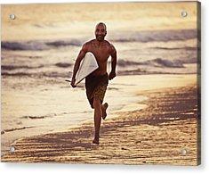 A Man Runs On The Wet Beach At Sunset Acrylic Print by Ben Welsh