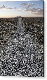 Ancient Rocky Road Leading To The Horizon. Acrylic Print by Edward Fielding