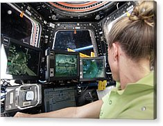 Astronaut In Iss Robotics Workstation Acrylic Print by Nasa