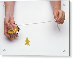 Boy's Hands Holding Gyroscope With String Acrylic Print by Dorling Kindersley/uig