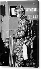 British Army Soldier In Riot Gear With Fire Extinguisher In Front Of Land Rover On Crumlin Road At A Acrylic Print by Joe Fox
